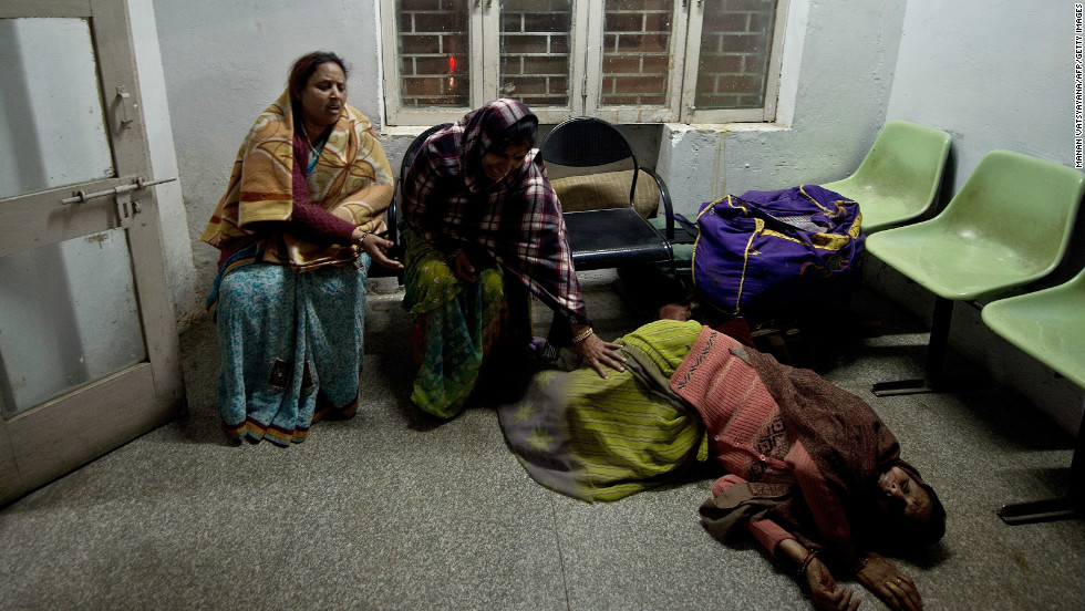 Indian women, caught in a stampede, reacts after not finding their relatives whom they last saw at the sight of the accident at the Railway Hospital in Allahabad on February 10, 2013.