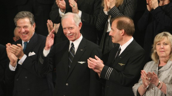 US Airways pilot Chesley Sullenberger (C) is applauded during US President Barack Obama's address to a Joint Session of Congress at the Capitol in Washington on February 24, 2009. Sullenberger was praised for his heroic job in ditching his stricken airliner in the Hudson River with no loss of life. AFP PHOTO/Chris KLEPONIS (Photo credit should read CHRIS KLEPONIS/AFP/Getty Images)