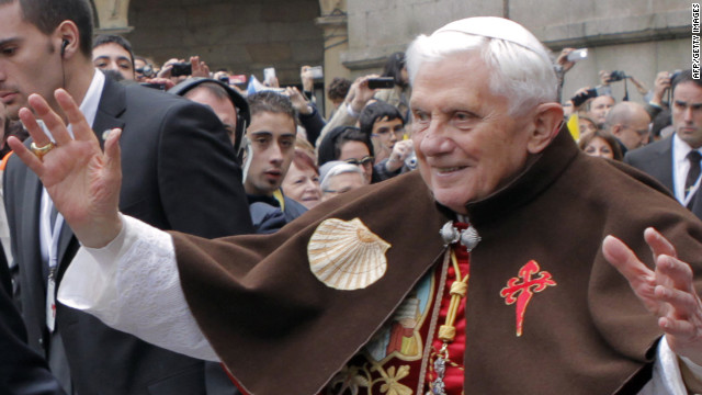 Pope Benedict XVI waves to faithful as he wears a pilgrim cape with a scallop shell and a Santiago cross embroidered on it during his visit in Santiago de Compostela, on November 6, 2010. Benedict XVI lands in Spain today to reclaim a bastion of the Church from the lure of quick divorce, abortion rights and gay marriage. AFP PHOTO/ POOL/ LAVANDEIRA JR (Photo credit should read Lavandeira jr/AFP/Getty Images)