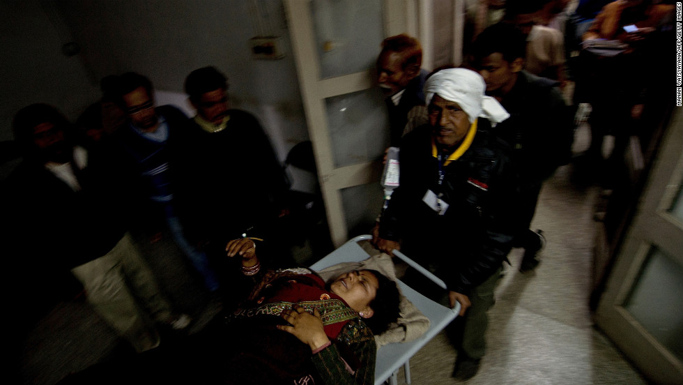Hospital attendants wheel in a woman injured in the stampede in Allahabad on Sunday, February 10. The stampede occurred about 7 p.m. after someone fell from a platform bridge in Allahabad, the scene of this year's Kumbh Mela festival, North-Central Railway spokesman Sandeep Mathur said. He said the station was overcrowded with pilgrims, but denied reports that the bridge had collapsed.
