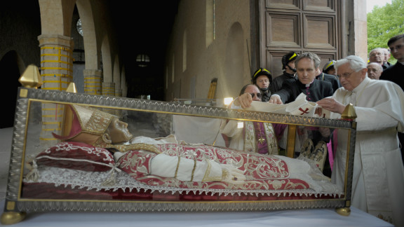 Pope Benedict XVI covers the relic of Pope Celestine V with a stole during his 2009 visit to L