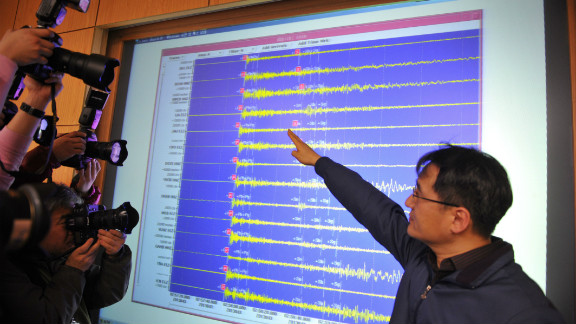 An official of the Korea Meteorological Administration shows a seismic image of a tremor caused by North Korea