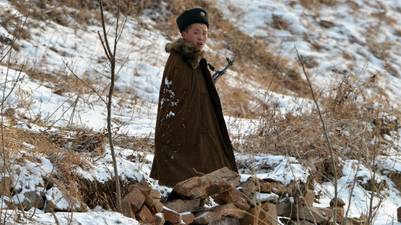 A North Korean soldier patrols along the Yalu River near the North Korean town of Sinuiju on February 12, 2013.