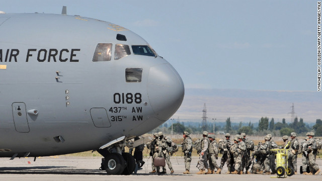 US soldiers board a plane to Afghanistan from a base in Bishkek, Kyrgyzstan in July 2010.
