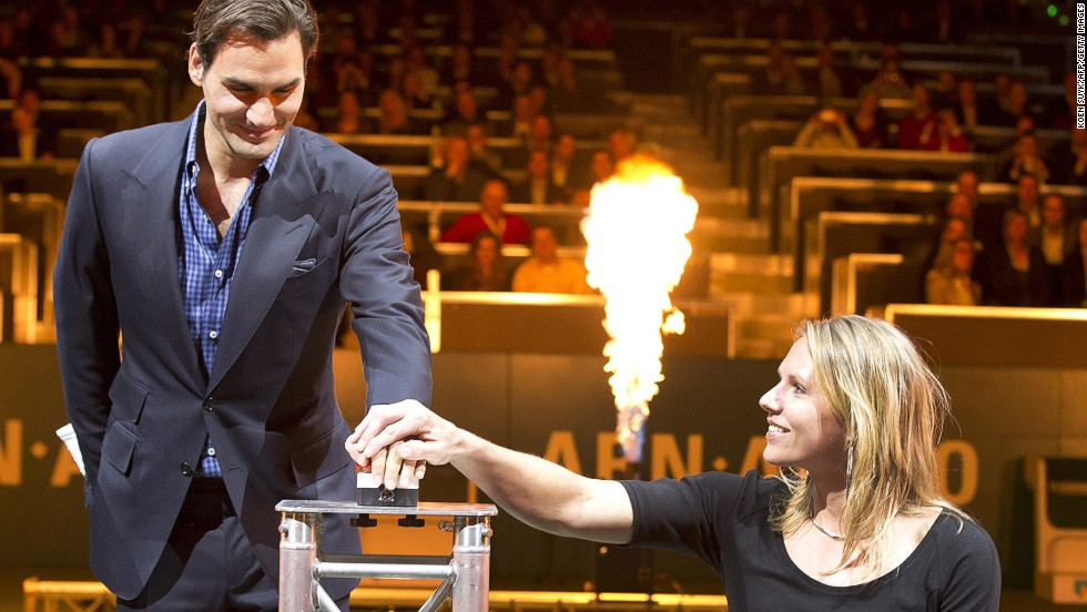 Vergeer with the Dutch tournament's defending champion Roger Federer at the opening ceremony on February 11, marking its 40th anniversary