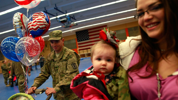 A soldier of the 170th U.S. Army Infantry Brigade, returned from Afghanistan, reunites in Germany with his family.