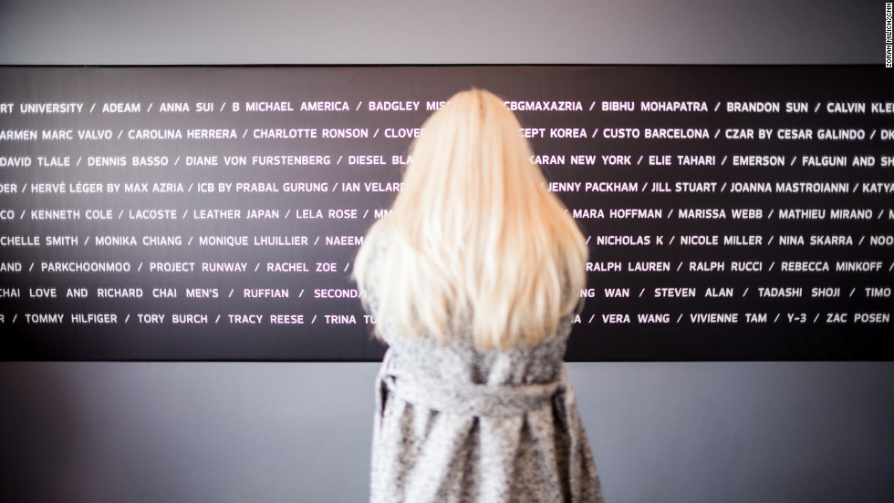 A guest looks at the designer board in the lobby of the Lincoln Center at New York Fashion Week on Tuesday, February 12.
