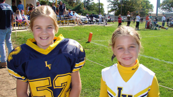 Alexandra, 11, a cheerleader, likes to watch her twin sister play and wants the rule changed.
