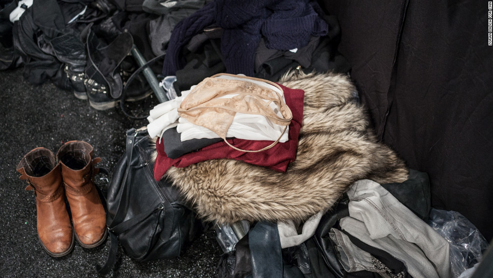 Clothes are piled up at a change station backstage at the Brandon Sun show on February 13.