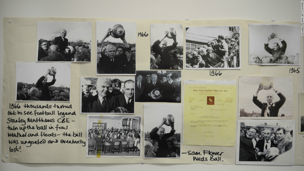 Historical pictures are displayed in the town hall before rival teams the 'Up'ards and Down'ards' battle for the ball in the annual Shrove Tuesday 'no rules' football match.