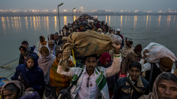Hindu pilgrims walk across a pontoon bridge on the banks of Sangam on Tuesday, February 12, at the confluence of the rivers Ganges, Yamuna and the mythical Saraswati.