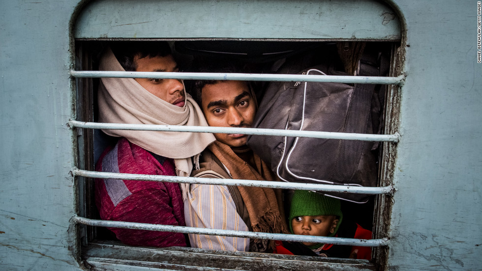 Hindu pilgrims pack tightly into a train car at Allahabad train station on Monday, February 11, where a deadly stampede occurred the night before.