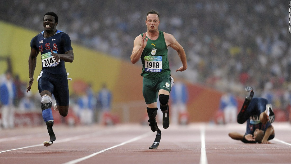 Pistorius wins gold ahead of Americans Jerome Singleton, left, and Marlon Shirley, right, in the 100-meter T44 during the 2008 Beijing Paralympic Games.