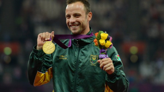Pistorius poses on the podium with his gold medal after winning the men