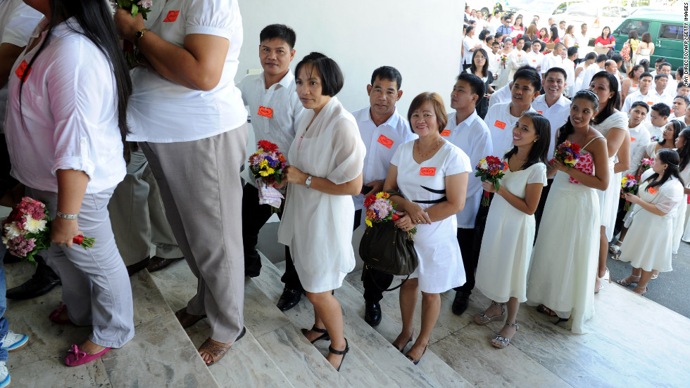 Hundreds of couples wait in line for a mass Valentine's Day wedding in Manila, Philippines.