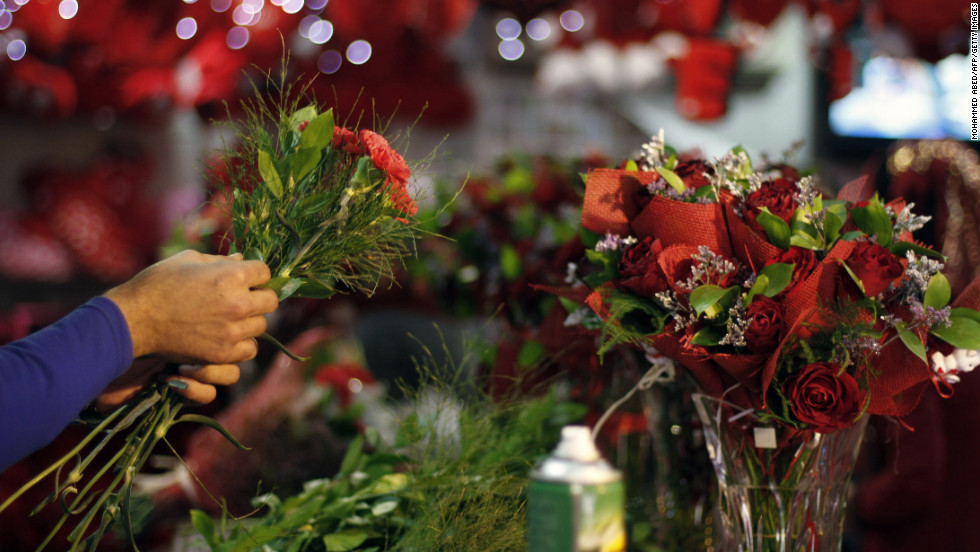 A shopkeeper prepares bouquets at a flower market in Gaza City.