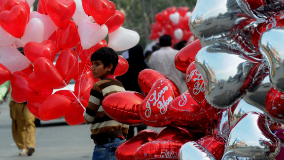 A vendor sells heart-shaped Valentine's Day balloons in Lahore, Pakistan.