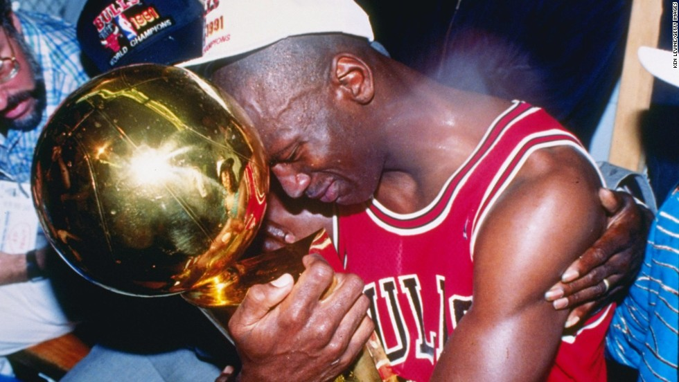 fdc7c47016fb Michael Jordan of the Chicago Bulls hugs the NBA Championship Trophy after  the Bulls defeated the