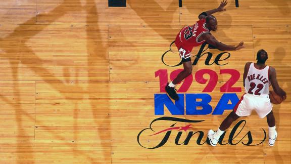 Clyde Drexler of the Portland Trailblazers drives against Jordan during the 1992 NBA Finals.