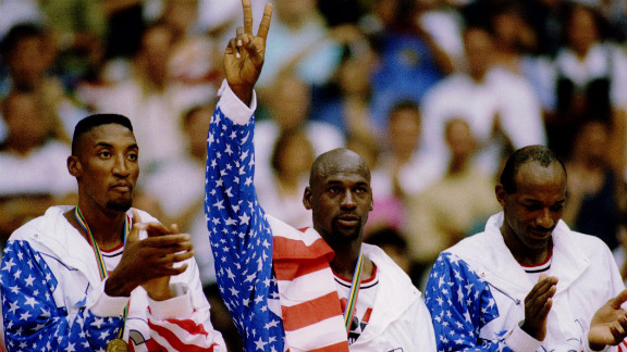 Olympic Dream Team members, left to right, Scottie Pippen, Jordan, and Clyde Drexler accept their gold medals in Barcelona, Spain, in 1992.