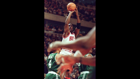 Jordan puts up a shot against guard David Wesley of the Boston Celtics in 1996.