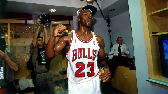 Jordan celebrates winning the NBA title after defeating the Seattle SuperSonics in Game 6 of the 1996 NBA Finals.