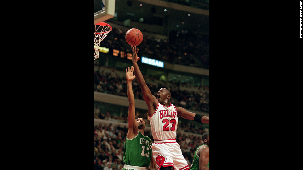 Jordan jumps to shoot the ball during a game against the Boston Celtics in 1997.
