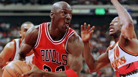 Jordan tries to get around Mookie Blaylock of the Atlanta Hawks in 1997.
