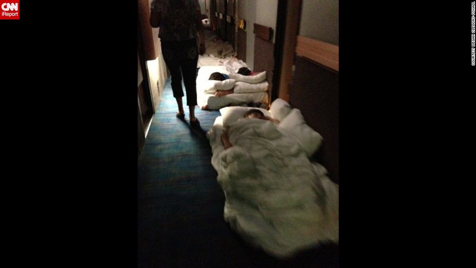 Passengers lie on mattresses in a hallway aboard the Carnival Triumph.