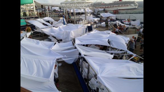 "iReporter Robin Goebel says passengers dubbed an area ""tent city"" where many had chosen to set up temporary shelters on the deck of the disabled Carnival Triumph. Many slept on the decks of the ship because the rooms were too hot."
