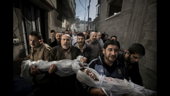 World Press Photo of the Year: Suhaib Hijazi, 2, and his brother, Muhammad, 3, were killed when an Israeli airstrike struck their Gaza City house, photographer Paul Hansen said. Their father, Fouad, was also killed, Hansen said. In the photo, Fouad