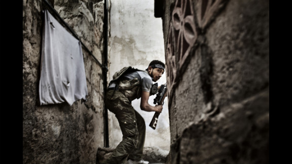 Second prize -- spot news stories:   A Free Syrian Army fighter during clashes against government forces in Aleppo, Syria, on October 10, 2012.