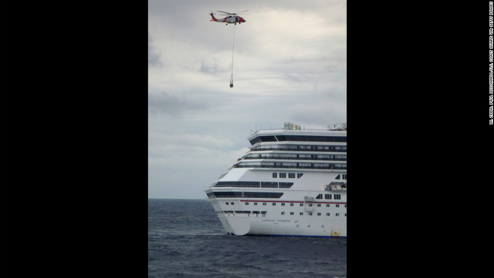 A U.S. Coast Guard helicopter delivers equipment, including a generator and electrical cables, to the Triumph on Wednesday, February 13, in the Gulf of Mexico.