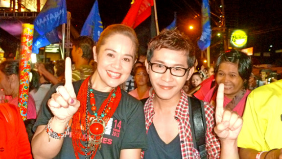 Monique Wilson and Ivan Phell Enrile attend a rally in Quezon City, Philippines.