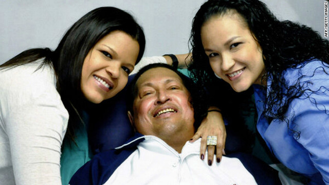 A photo from Venezuelan Information Minister Ernesto Villegas' Twitter account shows Hugo Chavez and his daughters.