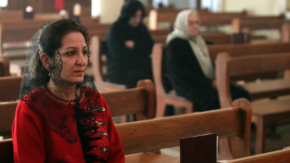 A woman attends Mass at a Chaldean church in Baghdad four years ago. Many Iraqi Christians have fled Iraq because of war and persecution.