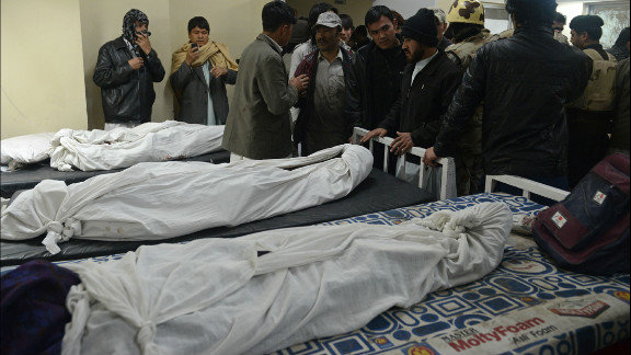 Locals gather at a morgue to identify the remains of relatives.