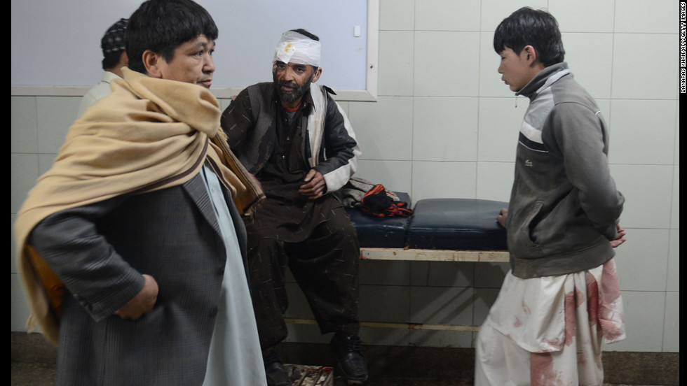 Relatives gather around an injured victim at a hospital in Quetta.