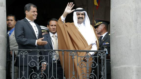 Ecuadorian President Rafael Correa hosted Qatar's Emir Hamad Bin Khalifa Al-Thani, waving, in Quito Saturday.