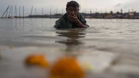 A Hindu devotee bathes in the Sangam on February 16.