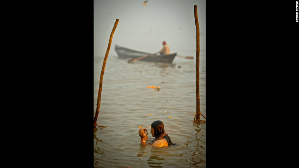 A woman bathes in the Sangam on February 17.