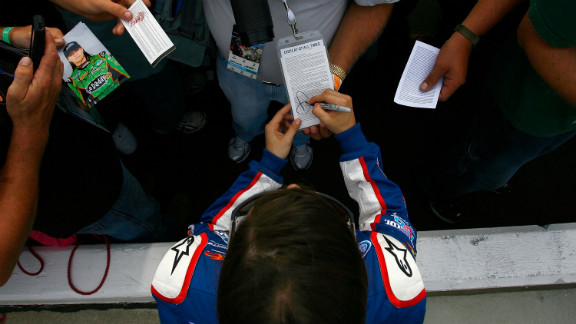 Patrick signs autographs during qualifying for the CARFAX 250 in 2010 in Brooklyn, Michigan.