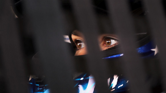 Patrick sits in her car in the garage area during practice for the VFW Sport Clips Help a Hero 200 in 2012 in Darlington, South Carolina.