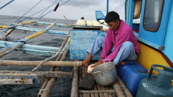 It's a tough life with the men working, eating and sleeping on these rickety boats hundreds of miles from home.