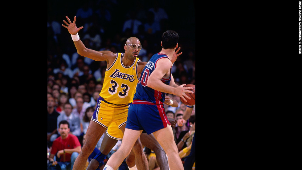 The so-called Showtime Lakers won their last championship of the era. The team couldn't keep up with Detroit's Motor City Bad Boys, who went on to back-to-back championships in 1989 and 1990. Pictured, Abdul-Jabbar of the Lakers defends against Bill Laimbeer of the Detroit Pistons during a 1988 NBA Finals game.