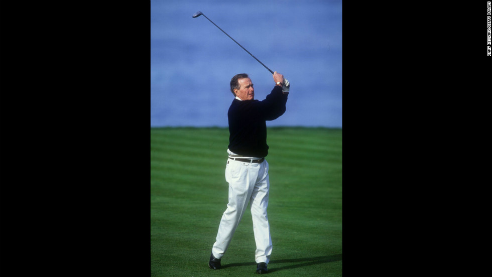 President George H.W. Bush tees off on the fourth hole at Spyglass Golf Course during the AT&T Pebble Beach National Pro-Am on February 28, 1994, in California.