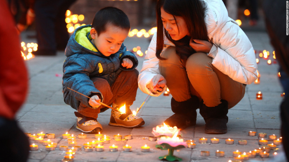 People light candles at Guangren Temple on February 17.