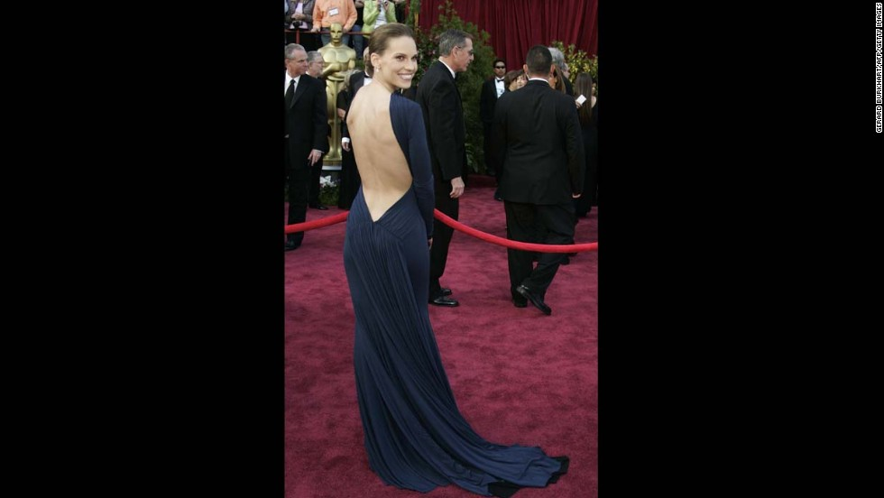 "When ""Million Dollar Baby"" actress Hilary Swank arrived at the Oscars in 2005, she was in a dress that, at first glance, appeared to be a fatal miss. It was long-sleeved, navy blue and didn't show a hint of decolletage. And then she turned around, and all those red-carpet rules were broken. It was fitting that she went on to win the best actress Oscar that night."