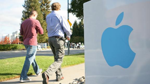 Employees stroll on Apple