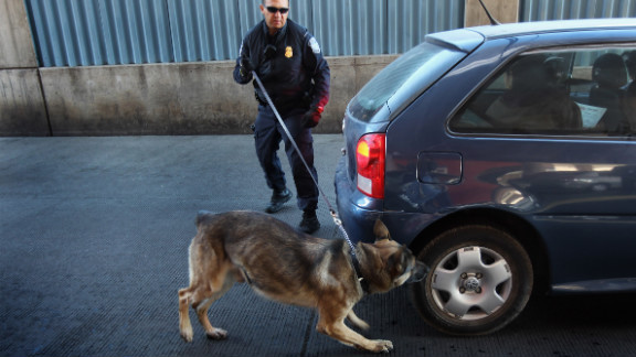 """The Supreme Court found Tuesday that a positive """"hit"""" from the sniff of a police dog could establish probable cause for the search of a vehicle."""